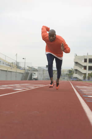 Athlete running on the running track LANG_EVOIMAGES