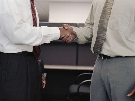 Mid section view of two businessmen shaking hands Stock Photo - 16070377