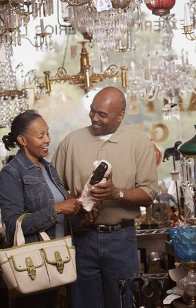 Couple shopping in antique shop Stock Photo - 16070468