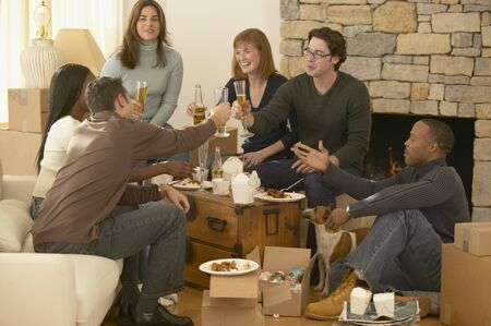 Small group of friends indoors 版權商用圖片