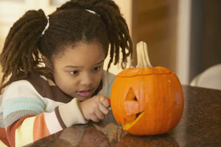 Young girl with pumpkin Stock Photo - 16070482