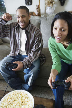 Brother and sister playing video game Stock Photo - 16070498