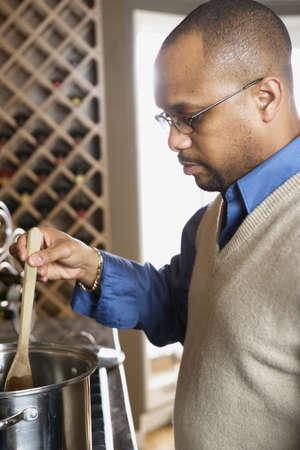 Man in kitchen preparing dinner Stock Photo - 16070517