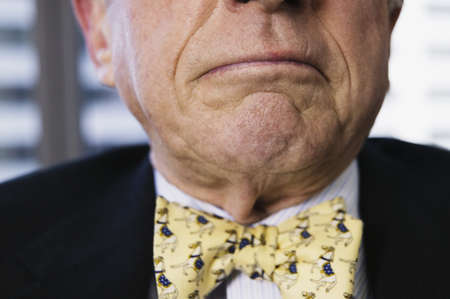 Senior businessman frowning Stock Photo - 16070535