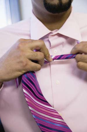 unwinding: Businessman removing tie