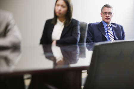 strategizing: Businesspeople sitting at conference table