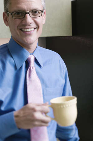 Businessman holding coffee cup Stock Photo - 16070547