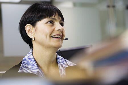 Businesswoman wearing headset Stock Photo - 16070569