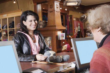 Female customer in yarn shop Stock Photo - 16070572