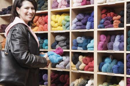 Female customer in yarn shop Stock Photo - 16070573