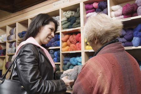 two persons only: Two women shopping for yarn LANG_EVOIMAGES