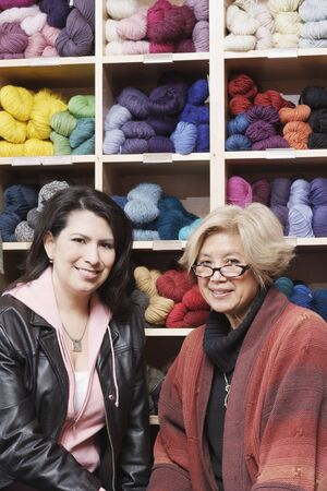two persons only: Portrait of two women in front of yarn
