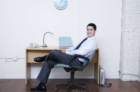 Businessman sitting at his desk Stock Photo - 16070590