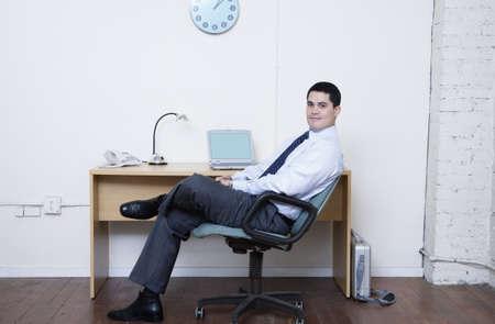 Businessman sitting at his desk Stock Photo - 16070590