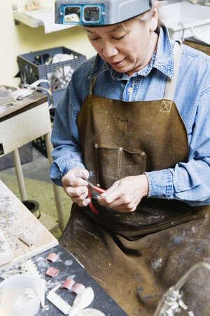 Female welder using pliers Stock Photo - 16070604
