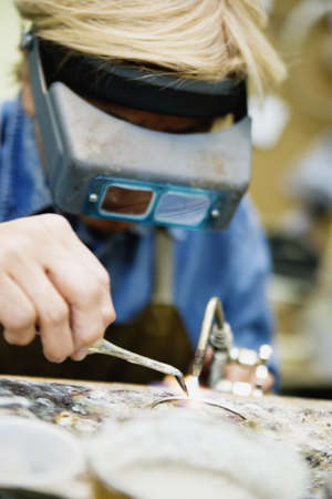 Welder using welding torch Stock Photo - 16070606
