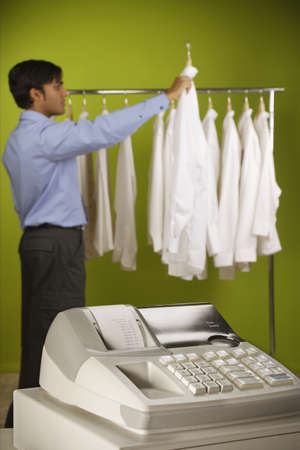 Side profile of a young man choosing clothes Stock Photo - 16070628