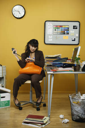 hectic: Businesswoman sitting at desk