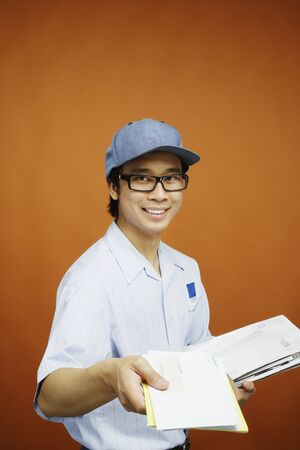 Postman delivering mail Stock Photo - 16070652