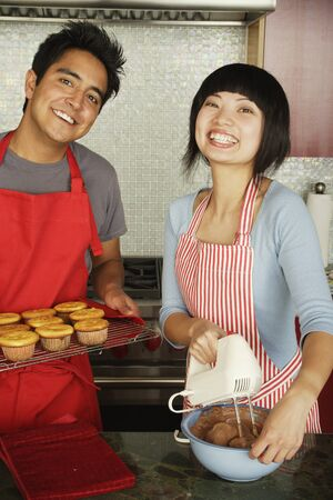 Couple baking together in kitchen