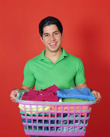 Man holding basket with folded clothes Stock Photo - 16070675