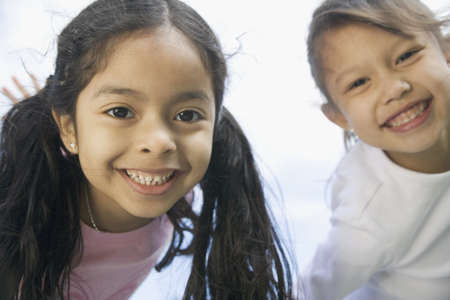 chums: Portrait of two young girls LANG_EVOIMAGES