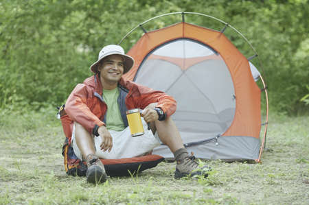 roughing: Young man at his campsite