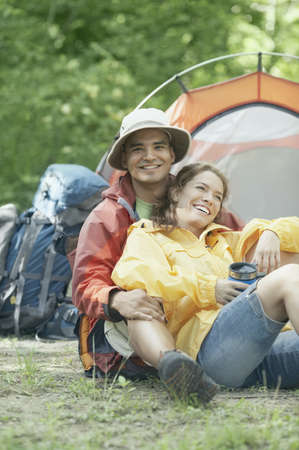 Couple embracing at their campsite Stock Photo - 16070729