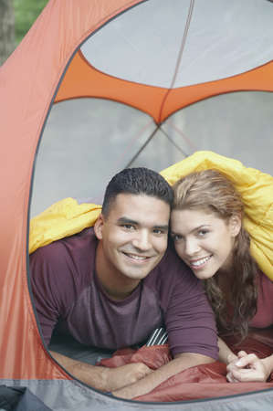 Young couple in a tent Stock Photo - 16070731
