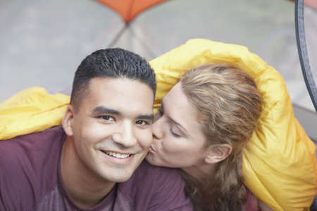 Woman kissing man in a tent Stock Photo - 16070732
