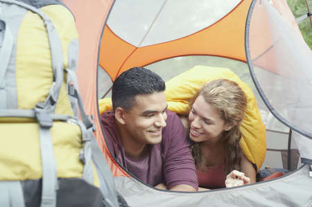 Young couple in a tent Stock Photo - 16070733