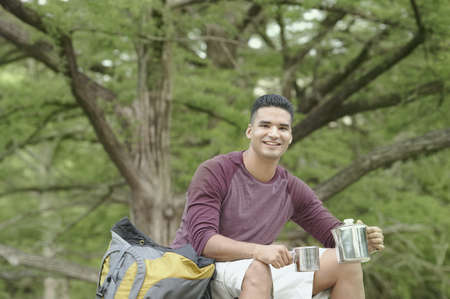 roughing: Young man camping in a forest LANG_EVOIMAGES