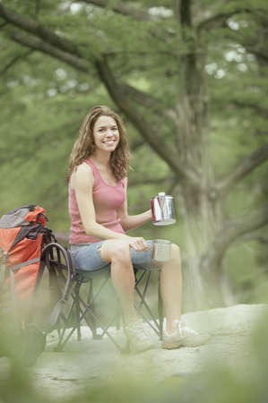 Young woman with camping gear Stock Photo - 16070736