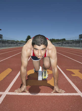 Male track athlete at the starting line Stock Photo - 16070755