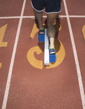 Rear view of track athlete at starting line Stock Photo - 16070756