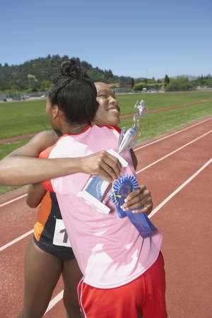 Female track and field winner Stock Photo - 16070763