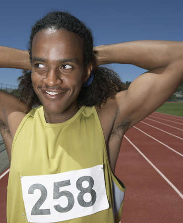 Male track athlete stretching before race Stock Photo - 16070767