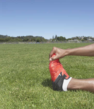 Male track athlete stretching Stock Photo - 16070769
