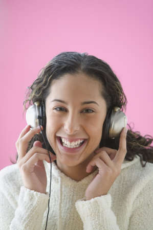 Teen girl listening to music with headset Stock Photo - 16070779