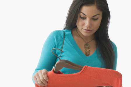 obsessive compulsive: Teenage girl looking at sweater
