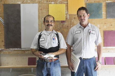 Two workers in a tile showroom Stock Photo