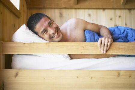 Young man waking up in bunk bed Stock Photo - 16070803