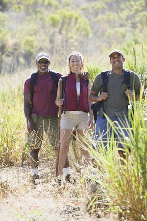 mixed age: Mixed age group of hikers in a field
