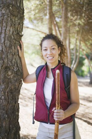 Portrait of young woman with walking stick Stock Photo - 16070812