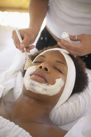 Young woman receiving facial massage Stock Photo - 16070851