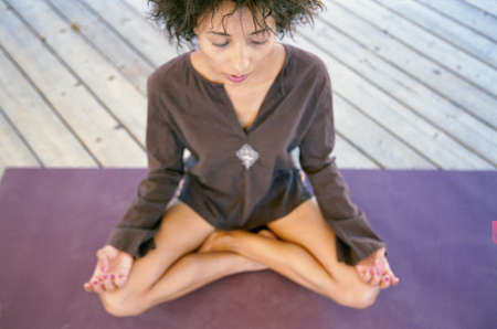 transcendent: Woman sitting in lotus position