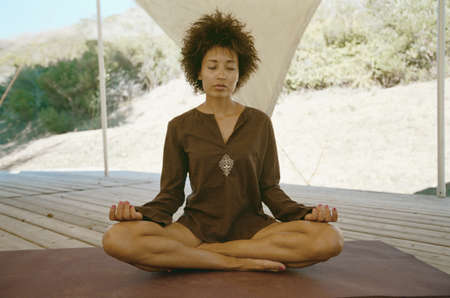 transcend: Woman practicing yoga in natural setting LANG_EVOIMAGES