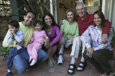 Hispanic family posing for a photo on a porch Stock Photo - 16070859