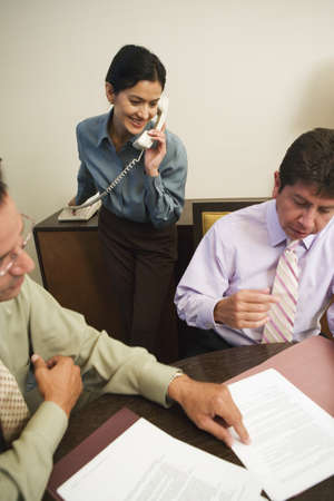 Business professionals reviewing paperwork Stock Photo - 16070867