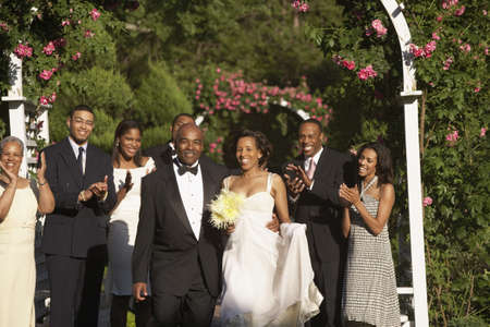mixed marriage: Wedding guests applauding newlyweds LANG_EVOIMAGES